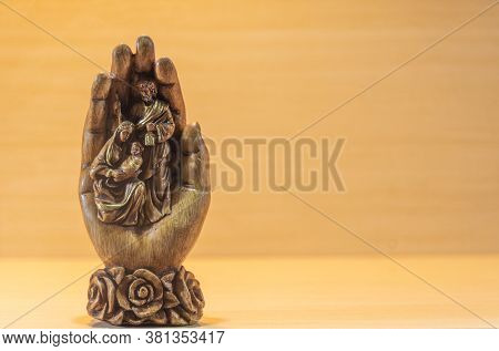 Image Of The Holy Catholic Family Carved Out Of A Hand...