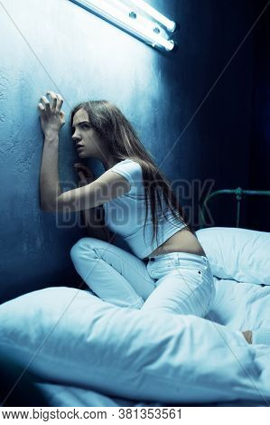 Stressed psycho woman sitting in bed, insomnia
