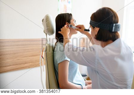 Female ent doctor and patient in office, ear exam