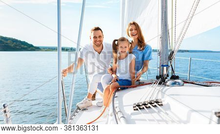 Cheerful Family Sitting On Yacht Deck Having Boat Ride Outdoor Spending Summer At Seaside. Panorama,