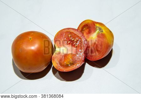 Fruits Of The Solanum Lycopersicum Plant On The Table, Better Known As