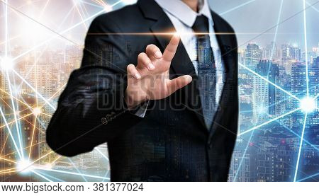 Double Exposure Of Business Man Pointing Space On City Night Background, Internet Of Things And Adve