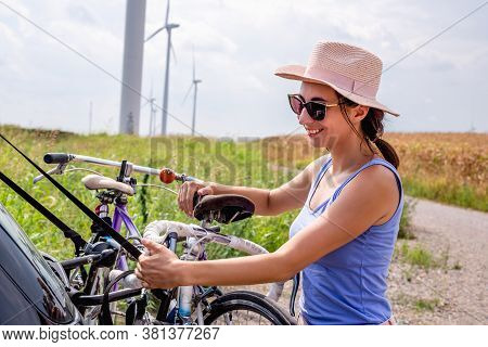 Cycling In Countryside. Lifestyle Concept. Hipster Woman Cycling In Countryside. Healthy Lifestyle.