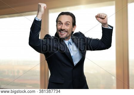Lucky Successful Businessman Clenched His Fists. Emotional Caucasian Man In Business Suit Celebratin