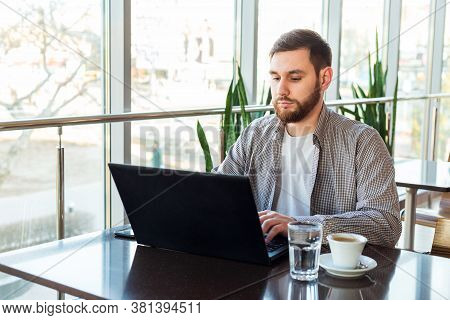 Remote Work. Businessman Using Laptop, Caucasian Man Sitting At Table In Cafe, Working On Laptop, Dr
