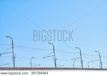 Minimalistic Road Lights, Copy Space. Lampposts On City Bridge. Streetlights With Wires.