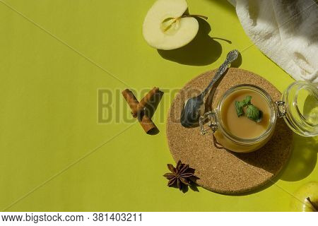 Healthy Organic Homemade Applesauce, Mousse, Sauce In A Glass Jar On A Green Background. Organic Nat