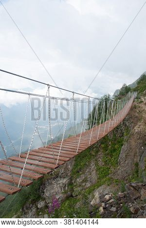 Skypark. An Extreme, Wooden Rope Suspension Bridge Over The Chasm Between Two Mountain Peaks. Around