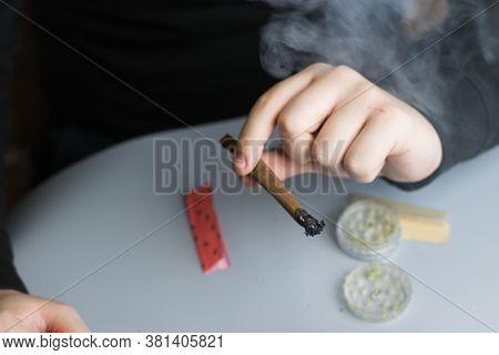 Man Smoking Cannabis Blunt. Smoke Clouds. Marijuana Medical Use.