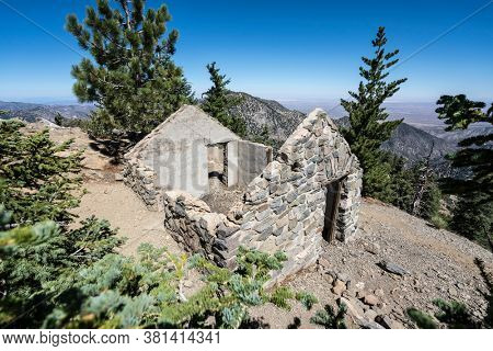 Stone cabin ruin and mojave desert view from Mt Islip peak in the San Gabriel Mountains area of Los Angeles County, California.