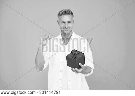Won A Prize Box. Happy Man Hold Gift Box Making Winner Gesture. Happy Owner. Happy Celebration. Birt