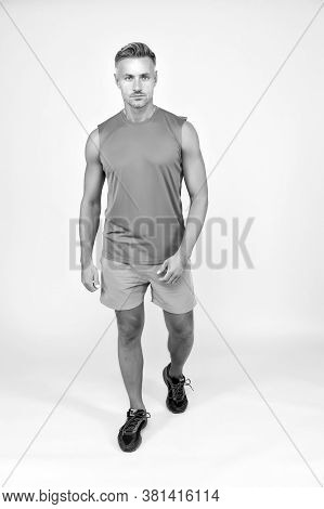 Train All Your Muscles. Muscular Man Yellow Background. Fit Athlete In Sportswear. Sportsman With Mu