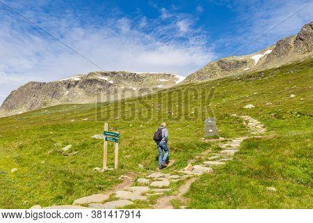 Geilo, Norway, July 17 2019: People Walking Up Hallingskarvet At Prestholtseter Service Station Near