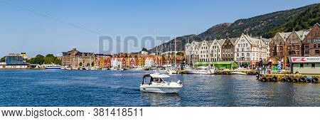 Bergen, Norway, Scandinavia - July 30, 2019: Ship Entering The Port Of Bergen With View On The Histo