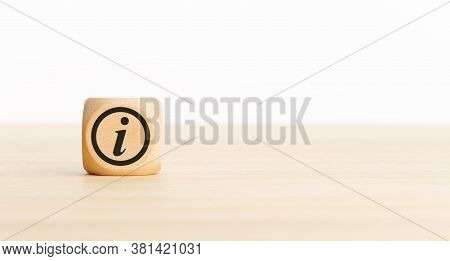 Info Or Information Concept Banner . Wooden Block With Info Icon On Desk. Copy Space
