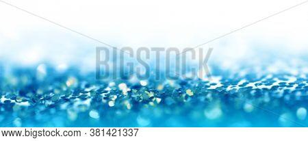Soft de-focus backgound. Gold (bronze) glitter shine dots confetti. Abstract light blink sparkle.