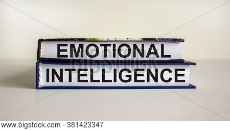 Books With Text 'emotional Intelligence' On Beautiful White Table. White Background. Business Concep