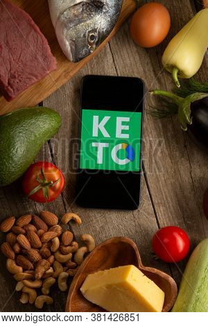 Keto Diet Recipes logo app on smartphone. Diet Plan On Tablet Pc And Vegetables. Belgorod , Russia - AUG, 18, 2020: