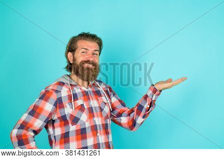 Advertisement. Advertising. Discount. Sale. Smiling Bearded Man Shows Something. Advertising Content