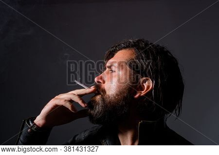 Man Smoke The Cigarette. Handsome Man With Cigarette. Cigarette Smoke. Brutal Man Smoking. Tobacco.