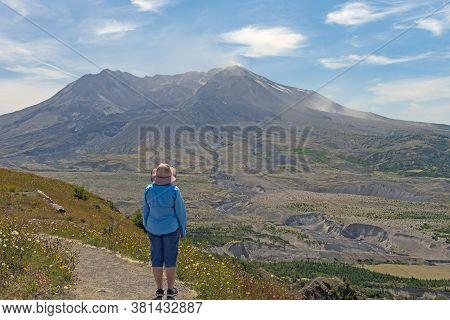 Hiker Pondering The Destruction Of Mt St Helens In Washington