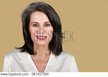 Studio Portrait Of A Beautiful Mature Woman