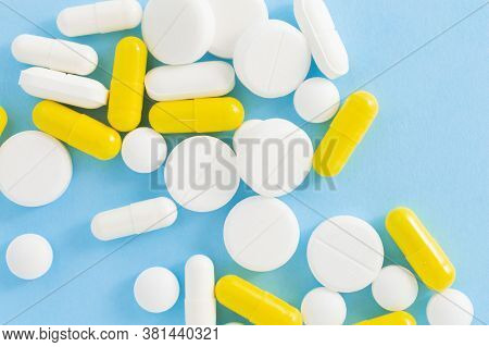 Multicolored Pills On Blue Background, Top View. The Concept Of Medicine Or Health Care.