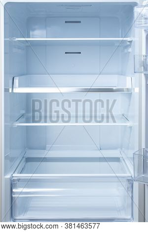 Empty Open Fridge With Shelves, Refrigerator. Mockup Background Empty Shelves For Your Products. Ope