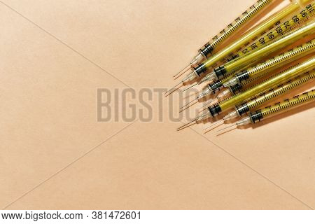 Medical Syringes For Injections Lying Isolated Over Light Background. Injection Medicine Concept. Sp