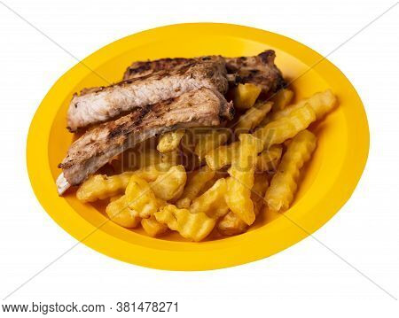 Grilled Pork Ribs With French Fries On Yellow Plate. Pork Ribs With French Fries On A White Backgrou