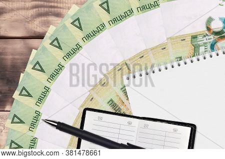 50 Belorussian Rubles Bills Fan And Notepad With Contact Book And Black Pen. Concept Of Financial Pl