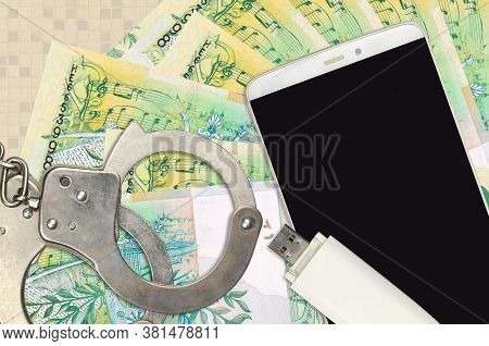 50 Belorussian Rubles Bills And Smartphone With Police Handcuffs. Concept Of Hackers Phishing Attack