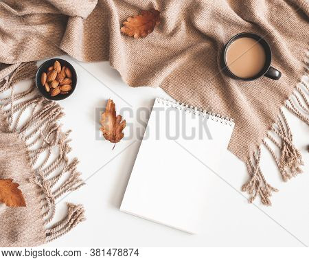 Autumn Composition. Cup Of Coffee, Plaid, Notepad, Autumn Leaves On White Background. Flat Lay, Top