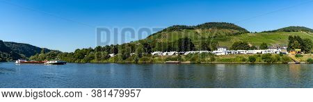 Enkirch, Rheinland-pfalz / Germany - 31 July 2020: Panorama Of A River Barge Travelling Up The Mosel