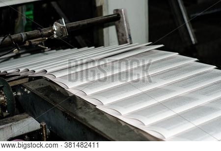 Printing Paper Newspapers In The Printing House. Printed Publications On The Industrial Conveyor. Pu