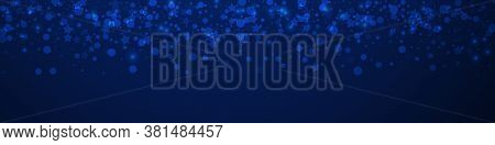 Magic Stars Sparse Christmas Background. Subtle Flying Snow Flakes And Stars On Dark Blue Background