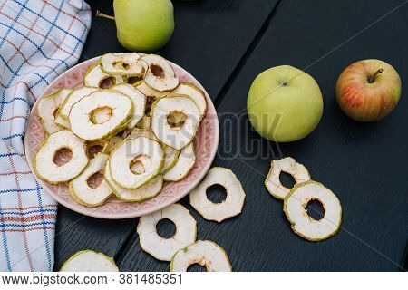 Dried Apple Slices In Open Glass Jar. Homemade Organic Dried Apple Chips With Fresh Apple On Black T