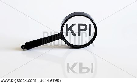 Magnifier With Text Kpi On White Background