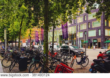 Amsterdam, Netherlands - August 16, 2017: Amsterdam-zuid. Traditional Dutch Bicycles Parked Along St