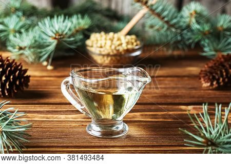 Cedar Products: Cedar Oil, Pine Nuts, Cones, Brunches On A Wooden Broun Background.