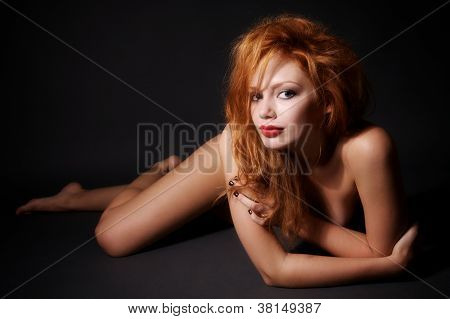 Young Nude Woman Lies On The Floor