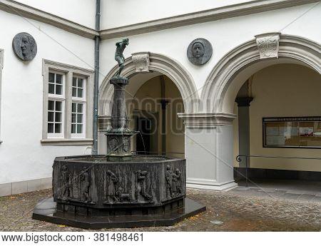 Koblenz, Rp / Germany - 1 August 2020: The Schaengelbrunnen Fountain In Koblenz With The Spitting Bo