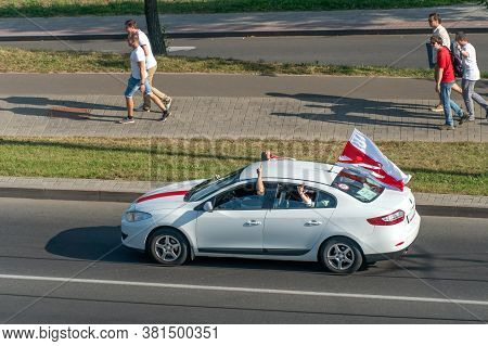 Mogilev, Belarus-july 16, 2020. A Man Waves A White-red-white Flag From A Car Window During A Peacef