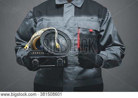 Car Audio Specialist Is Holding In Hand A Car Stereo Equipment And Is Showing A Thumbs Up.
