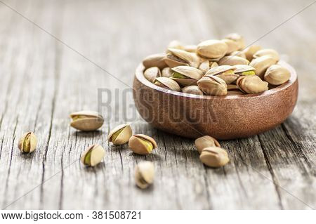Pistachio Nut In Nutshell On Wooden Rustic Backdrop In Bowl, Composition Of Pistachios Great For Hea