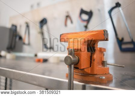Vise On The Carpenter Work Bench Close Up.