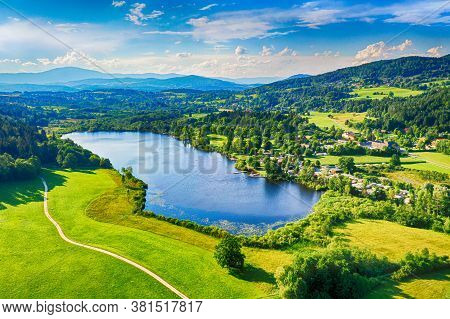 Hafnersee In Carinthia Region. Aerial View To The Famous Lake In The South Of Austria During Summer.