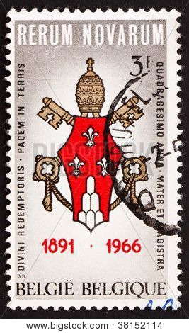 a stamp printed in the Belgium shows Arms of Pope Paul VI, 75th Anniversary of the Encyclical by Pope Leo XIII Rerum Novarum, circa 1966 poster
