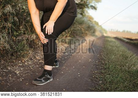 Woman Touching Her Leg, Got A Knee Trauma At Outdoor Jogging. Sports Injury, Health Care, Sports, Jo