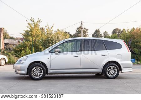 Novosibirsk, Russia - 08.05.20: Left Side View Of A Honda Stream Car In A Silver Body Japanese 2002